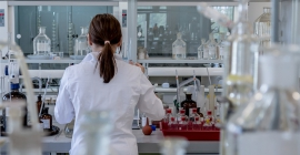 a woman working in a research lab